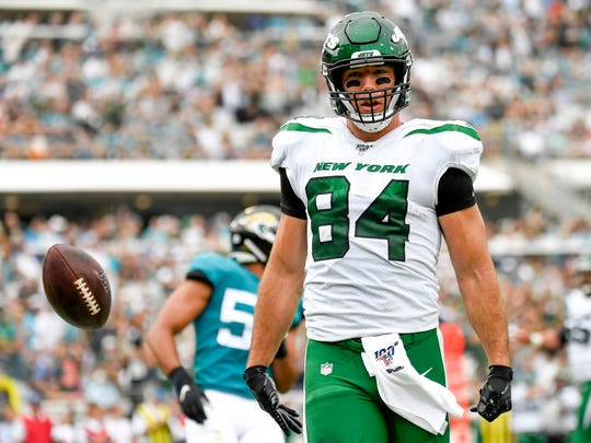 Oct 27, 2019; Jacksonville, FL, USA; New York Jets tight end Ryan Griffin (84) reacts after scoring a touchdown during the first quarter against the Jacksonville Jaguars at TIAA Bank Field. Mandatory Credit: Douglas DeFelice-USA TODAY Sports