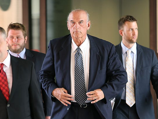 Former Minnesota governor Jesse Ventura, center, leaves