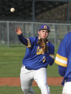 Ontario's Will Watkins throws to first base while playing at Clear Fork on Wednesday.