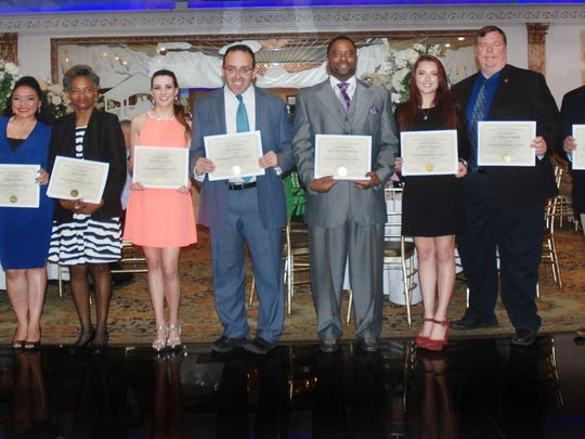 From left: Union County Freeholder Vernell Wright presented certificates of recognition and congratulated Clarissa Robles of Elizabeth, Queen King of Hillside, Kristina Geiger of Clark, Joe Narciso of New Providence, Sgt. Johnny Henderson of Plainfield, Alexis Monaco of Roselle Park, Lt. Thomas Nugent of Roselle and Bill Ilaria of Cranford on being named the 2016 Union County Municipal Volunteers of the Year by the Local Advisory Committee on Alcoholism and Drug Abuse (LACADA) at the group's annual volunteer recognition dinner in Union.