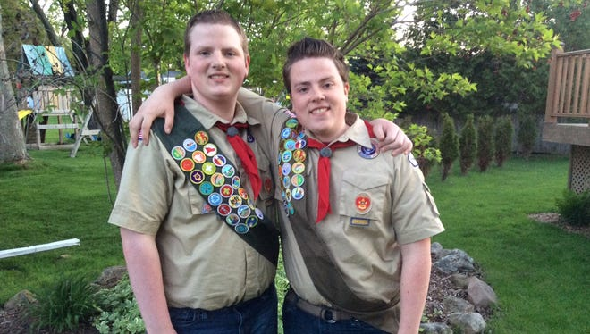 Parker Hambrick, left, and his elder brother Gavin Hambrick, pose in their Boy Scout uniforms. The Fond du Lac boys recently received their Eagle Scout rankings.