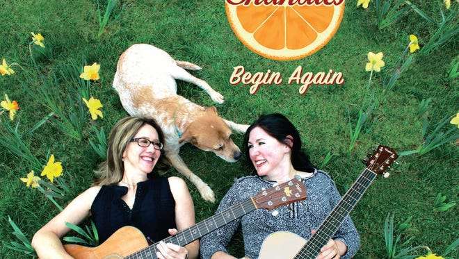 The Shandies' album cover: Shannon Stine (left) and Natalie Wlodarczyk with Penny the dog.