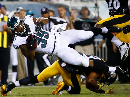 Philadelphia Eagles' Matthew Tucker (39) is tackled by Pittsburgh Steelers' Mike Mitchell (23) during the second half of an NFL preseason football game, Thursday, Aug. 21, 2014, in Philadelphia. (AP Photo/Matt Rourke)