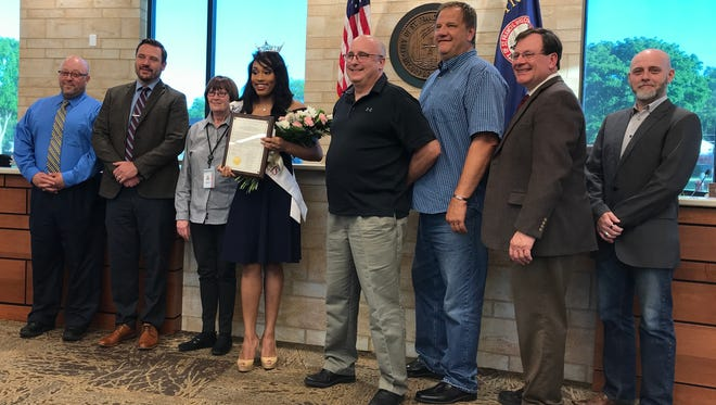 The St. Francis Common Council saluted Miss St. Francis Alexa Biami and wished her luck in the Miss Wisconsin pageant at its June 5 meeting. Pictured (from left) are Alderman Shawn Feirer, Alderman Matt Damon, Alderwoman Janice Schandel, Biami, Mayor Ken Tutaj, Alderman Steve Wattawa, City Administrator Mark Johnsrud and Alderman Brian Drew.
