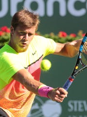 American Ryan Harrison hits a backhand return to Mardy Fish of the US on Thursday at the BNP Paribas Open in Indian Wells.