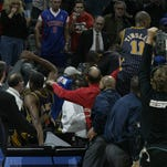 Indiana Pacers go into the stnd behind the csorer bench  during an  altracation in he last minute o thier game with the Pistons   at The Palace in Auburn Hills, MI on Friday November 19, 2004. (Photo by Julian H. Gonzalez / Detroit Free Press)