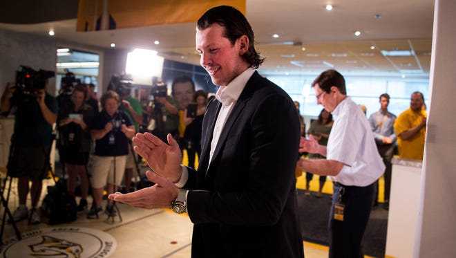 Ryan Johansen claps as he exits a press conference at Bridgestone Arena in Nashville, Tenn., Friday, July 28, 2017. The Predators signed a new contract with Johansen on Friday.