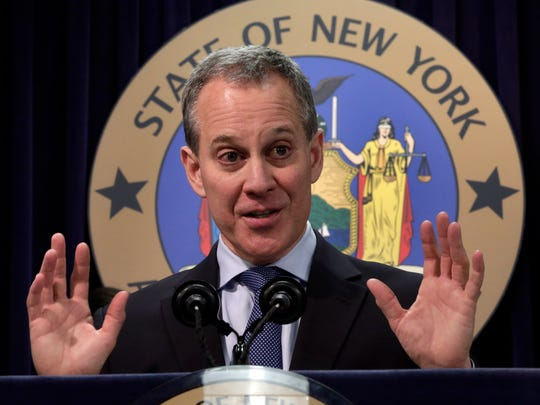 New York state Attorney General Eric Schneiderman addresses a news conference in his  New York offices, Tuesday, Nov. 19, 2013.