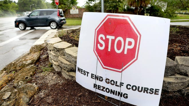 A sign opposing the rezoning of what was the West End Golf Course sits outside the Villages of West End neighborhood in Gainesville Thursday.