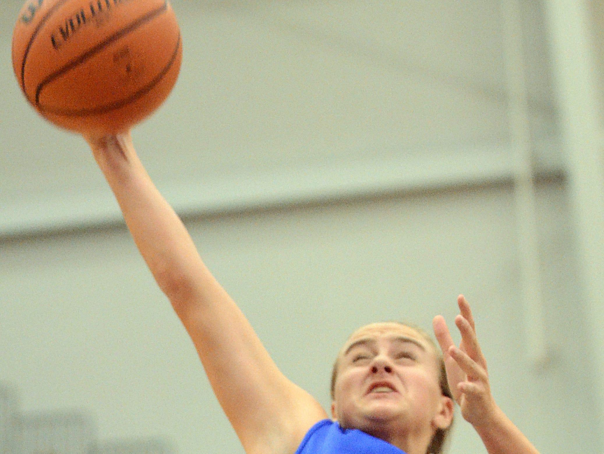 White House High sophomore guard McKenzie Vaughn grabs a second-quarter rebound. Vaughn scored three points.