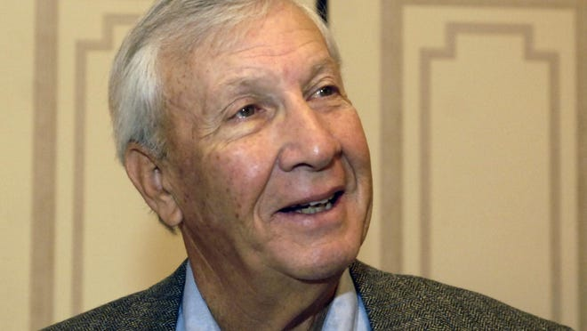 Pat Dye, a former head coach for East Carolina University, the University of Wyoming, and Auburn University, gives an interview during a media session with other 2005 College Football Hall of Fame Division 1-A inductees in New York on  Dec. 6, 2005.  Dye coached Auburn to six bowl victories in nine appearances and was three-time SEC Coach of the Year. He died Monday. He was 80.