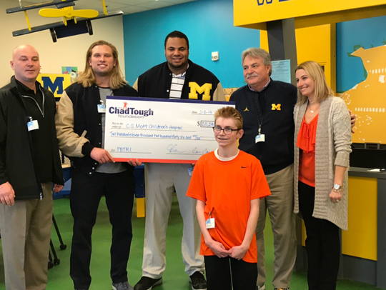 Michigan football players Chase Winovich and Grant