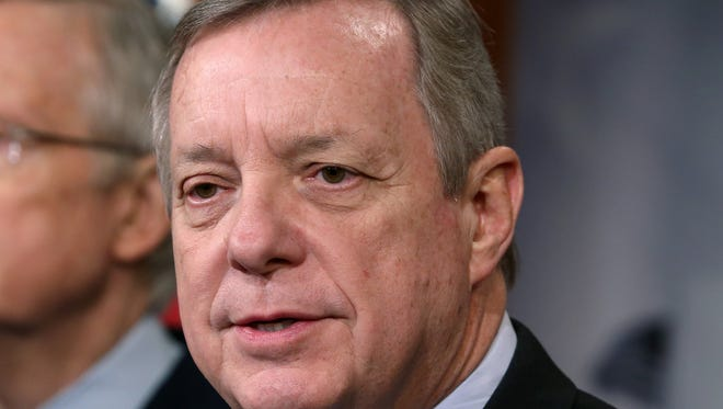 Sen. Dick Durbin, D-Ill., speaks during a news conference on Capitol Hill on Dec. 12, 2013.