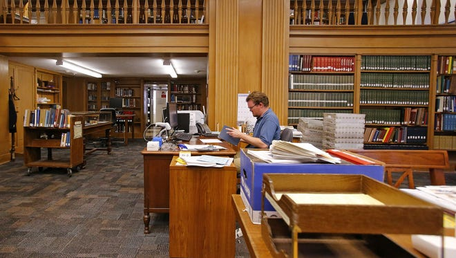 Library Associate Chris Seggerman works in the Arizona State Library's Genealogy Collection on July 28, 2015.