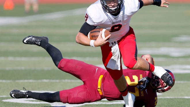 St. Cloud State University's Nate Meyer (8) turns out of a tackle attempt by Northern State University's Joe Parsley (27) during the first half of Saturday's game at Swisher Field in Aberdeen, South Dakota. Meyer went on to score the Huskies' second touchdown of the day on the play.