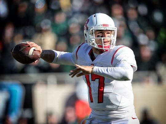 Rutgers quarterback Giovanni Rescigno (17) attempts to throw the ball during the second half of a game against the Michigan State at Spartan Stadium.