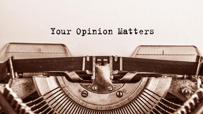 Text Your Opinion Matters typed on vintage typewriter retro. Close up