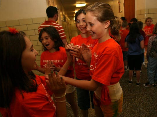From 2009: Demi Cassel, from left, Brielle Beites, Samantha Hywell and Olivia Cassidy, play for a few minutes before lunch at Washington School. The students wear with their orange shirts to show solidarity with their friend Allyn Lilien
