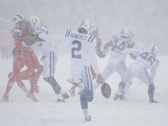 Indianapolis Colts punter Rigoberto Sanchez (2) punts to the Buffalo Bills in the second quarter at New Era Field in Orchard Park, N.Y., on Sunday, Dec. 10, 2017.