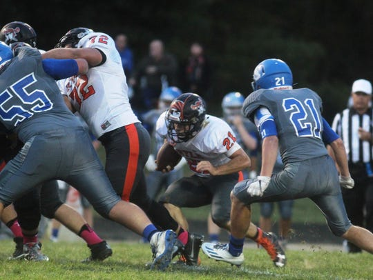 Ryle RB Jake Chisholm (21) looks for running room past