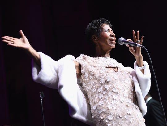 Singer Aretha Franklin performed.