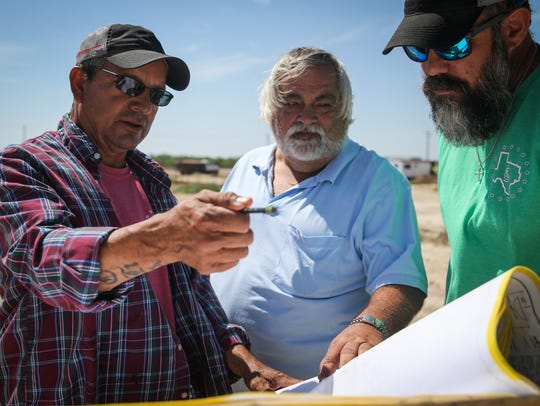 From left, Lone Star Contracting project foreman Arnold Rocha, Waldrop Construction superintendent Robert Wheat and Lone Star Contracting owner Slater Chapa look over blueprints May 10 at the Journey Recovery Center construction site.