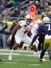 File- This Oct. 28, 2017, file photo shows North Carolina State defensive end Bradley Chubb (9) in action during the first half of an NCAA college football game against Notre Dame in South Bend, Ind. Chubb hasn't talked to reporters while doing only side work during practice for the Sun Bowl. Wolfpack coach Dave Doeren isn't making much of a secret of Chubb most likely sitting out the game against Arizona State, which would be the second straight year that the biggest story for the oldest bowl game in Texas was a highly touted NFL prospect opting not to play. (AP Photo/Darron Cummings, File)