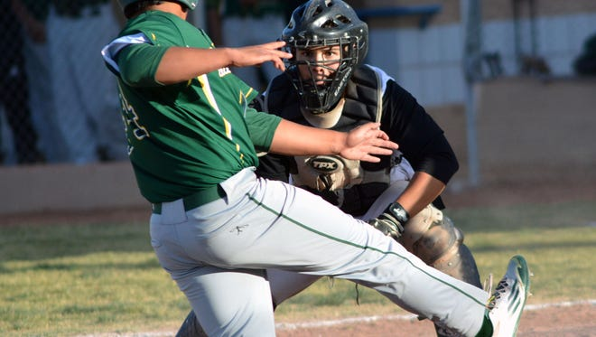 Oñate catcher Leo Calderon gets ready to put a tag on Mayfield's Alex Lopez at home plate during the first game of Friday night's doubleheader.