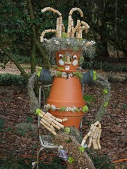 Clay pots and corks scarecrow.