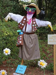 Juliette Gourd N' Crow girl-scout scarecrow.
