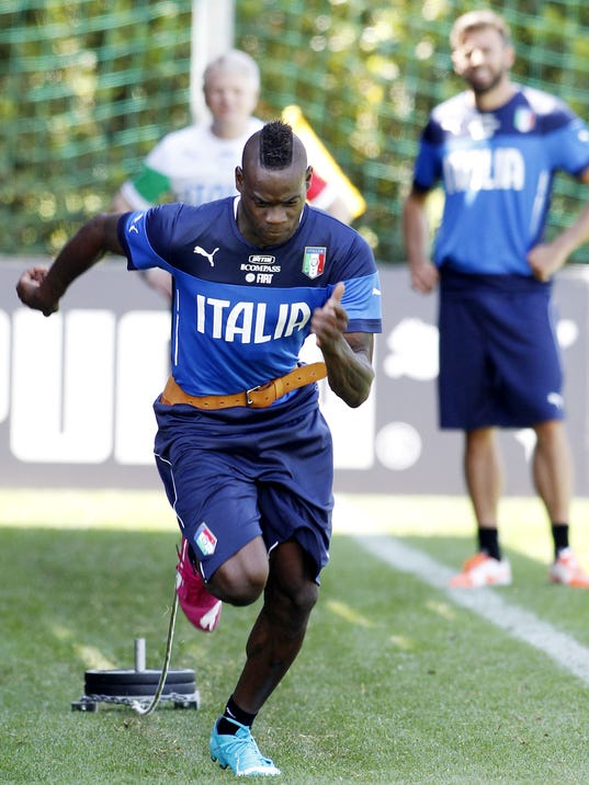 Italian player Mario Balotelli warms up during a training session in Coverciano training complex, in Florence, Italy, Tuesday, May 20 , 2014. The Azzurri will train for three days this week then resume full-time preparation next Monday. In Brazil, Italy is in Group D with England, Uruguay and Costa Rica. (AP Photo/Fabrizio Giovannozzi)