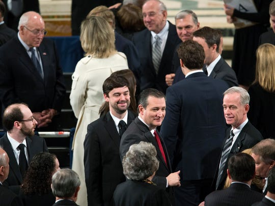 Republican presidential candidate, Sen. Ted Cruz, R-Texas, center, and former Vice President Dick Cheney, upper, left take their seats prior to a funeral mass for the late Supreme Court Associate Justice Antonin Scalia at the Basilica of the National Shrine of the Immaculate Conception in Washington, Saturday.
