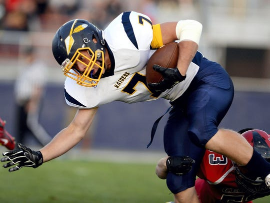 Elco running back Tyler Horst shed tacklers in the