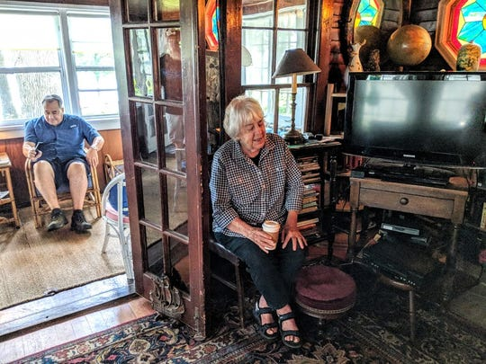 Lucy Holmes, 90, tells stories of the old cottage while son Jeffrey Holmes relaxes in the front porch that looks out to West Okoboji Lake.