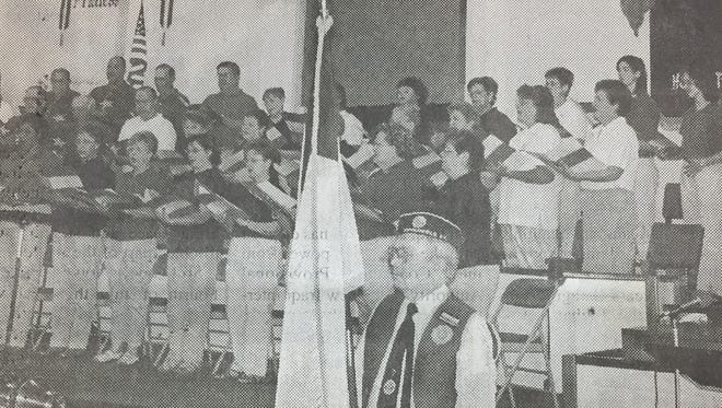 A July 4th service was held in 2004 at the Sturgis First Baptist Church. Here, Sonny Holt holds the Christian flag during the service.