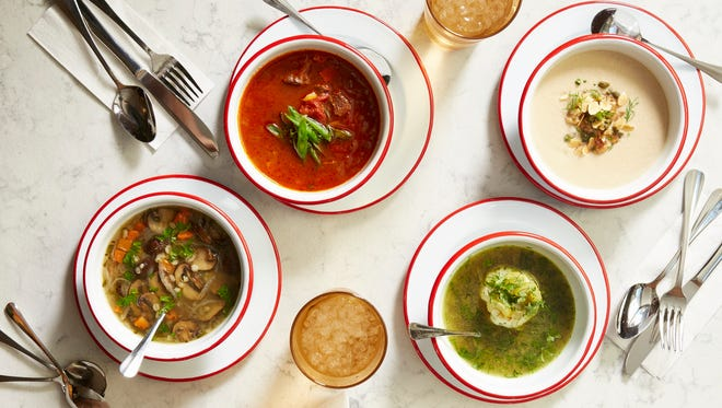 The menu at Rooster Soup Co. includes such choices as (from left to right) mushroom barley, beef and vegetable, smoked matzo ball and roasted cauliflower soups.