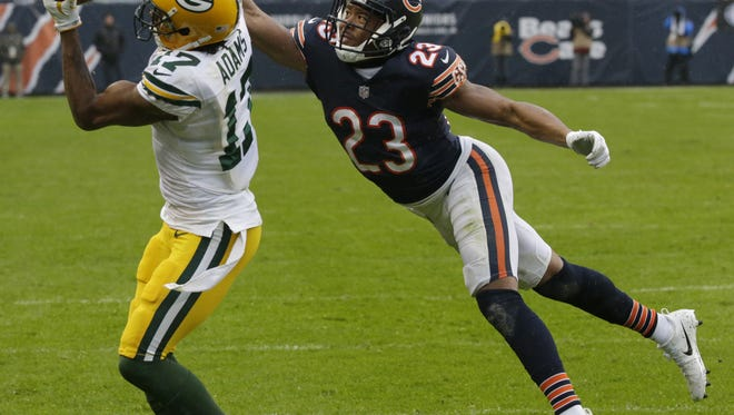 Green Bay Packers receiver Davante Adams (17) reels in a 19-yard touchdown pass while being covered by Chicago Bears cornerback Kyle Fuller (23) during the fourth quarter on November 12, 2017, at Soldier Field in Chicago.