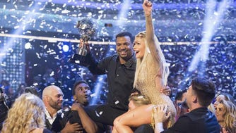 Alfonso Ribeiro, holding trophy, and partner Witney Carson celebrate after winning ABC's 'Dancing with the Stars.'