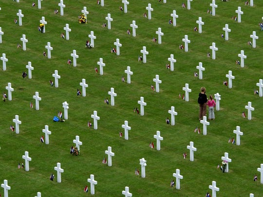 Margraten in modern times: People attend the 60-year commemoration service ahead of Memorial Day at the Netherlands American Cemetery in Margraten, southern Netherlands, Sunday May 30, 2004. A total of 8,302 war veterans and war victims are buried at the cemetery.