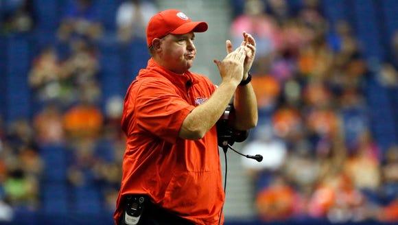 Louisiana Tech coach Skip Holtz claps his hands during