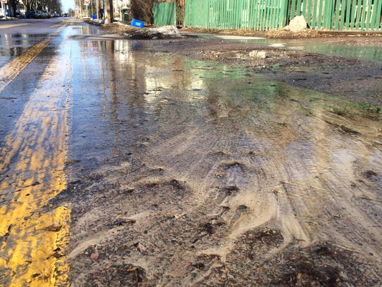 Silt and other debris flushes from a Burlington property