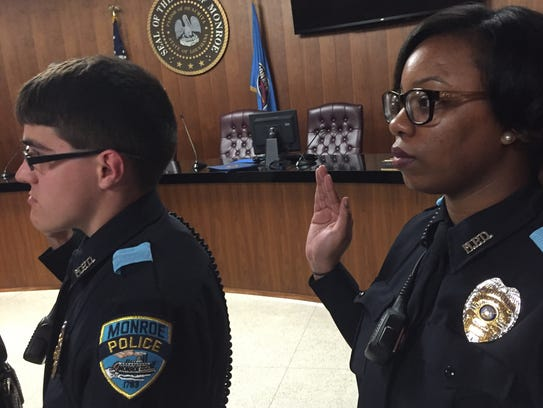 Officers Michael Hughes and RaKeida Brothers are sworn