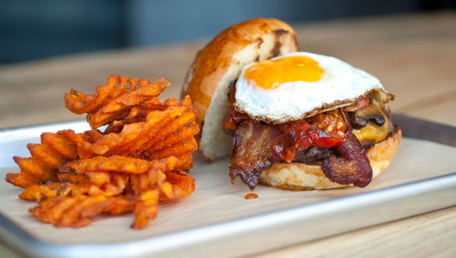 The Funk Zone burger with sweet potato waffle fries is a popular choice at Mesa Burger.