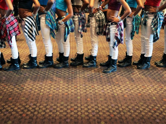"Dressed in matching ripped white jeans and combat boots, dancers from the group Black Ice from Cincinnati, Ohio, line up when their number is called to perform after waiting with other would-be stars to audition for ""America's Got Talent"" at the Cook Convention Center. The reality show ran an open casting call in Memphis as the ninth stop on a 10-city tour."