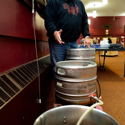 """Paul Johnson, president of the Red Ledge Brewers, explains how a three-tiered, gravity-fed system works before a meeting of the group at Sanctuary Spirits Monday in Grand Ledge. The home brewing group will be holding its """"Iron Brewer"""" competition on Saturday. The event is open to the public."""