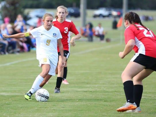 Westview midfielder Hayley Shumake looks to take on