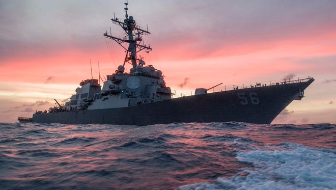 In this Jan. 22, 2017, photo provided by U.S. Navy, the USS John S. McCain conducts a patrol in the South China Sea while supporting security efforts in the region. The guided-missile destroyer collided with a merchant ship on Monday, Aug. 21, in waters east of Singapore and the Straits of Malacca.