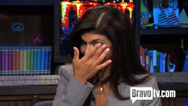 Reality star Teresa Giudice wipes away a tear on 'Watch What Happens Live' on Sunday.