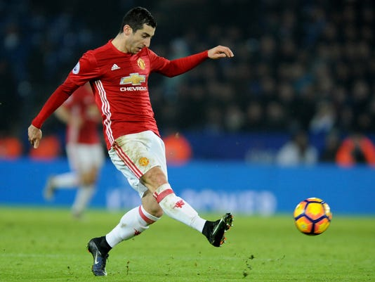 FILE - In this Sunday, Feb. 5, 2017 file photo, Manchester United's Henrikh Mkhitaryan controls the ball, during the English Premier League soccer match between Leicester City and Manchester United at the King Power Stadium in Leicester, England. Mkhitaryan is set to make his debut for Arsenal at Swansea after moving from Manchester United in a deal that saw Alexis Sanchez go the other way. Mkhitaryan endured an underwhelming 18-month spell at Old Trafford and wasn't the same player who joined for $33.5 million after starring in the German league for Borussia Dortmund.  (AP Photo/Rui Vieira, File)