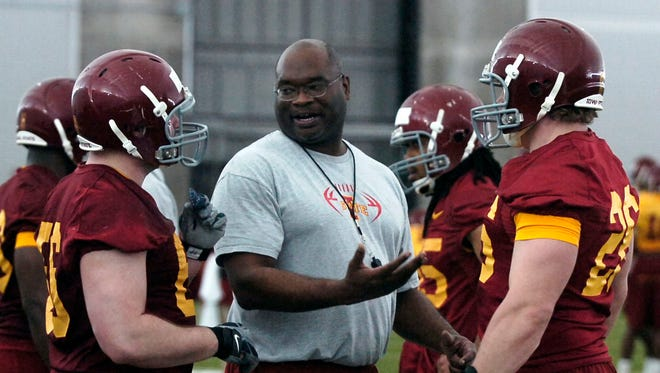 Iowa State defensive line coach Curtis Bray, center, talks with players during spring 2009 football practice.